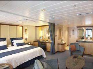 Описание на каюта Grand Suite - категория GS на круизен кораб LIBERTY of the Seas – обзавеждане, площ, разположение