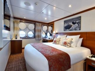 Описание на каюта Deluxe Ocean View Stateroom - категория XD на круизен кораб Celebrity Xperience – обзавеждане, площ