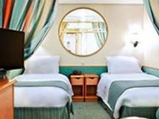 Описание на каюта Inside Guarantee Interior – категория ZI на круизен кораб EXPLORER Of The Seas  – обзавеждане, площ