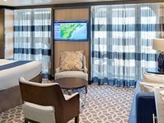 Описание на каюта Silver Junior Suite - Малък апартамент с балкон категория J4 на круизен кораб ODYSSEY of the Seas – обзавеждане, площ